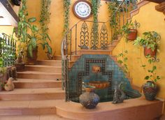 Love the hanging plants and iron railings