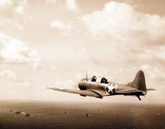 Operation Torch, November 1942. SBD Dauntless planes from USS Ranger (CV-4) en route to invade French North Africa. A Navy scout bomber flies on anti-submarine patrol. Official U.S. Navy Photograph, now in the collections of the National Archives.