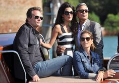 George Clooney and business partner Rande Gerber pose for the cameras with Cindy Crawford and Amal Alamuddin. The lovebirds took a water taxi in Venice, Italy, as they waved to the crowd on Sept. 26, 2014.