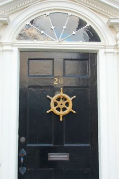 Nautical front door with white, Dark navy blue and Gold.