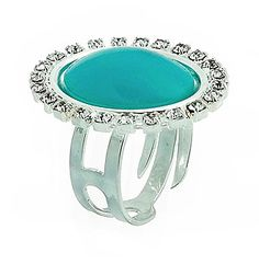 Anel ajustável folheado a prata com cabochão oval em acrílico rodeado de pedras de strass. www.joiasfolheadasdiretodafabrica.tk