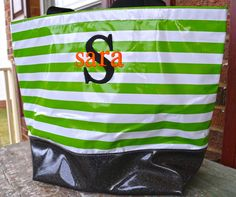 Another olicloth tote--green and white striped, black glitter bottom with black large mono and orange name!