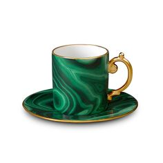 Enjoy espresso in opulent style with thisMalachite espresso cup & saucer by L'Objet.Meticulously crafted from Limoges porcelain with 24K gold detail around the rim and handle of the cup thisstri...