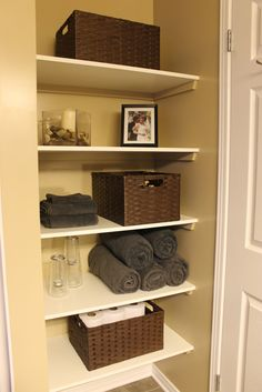 KM Decor: DIY: Organizing Open Shelving in a Bathroom    Boxes- Same type, arranged facing different directions    Towels - same color, arranged differently