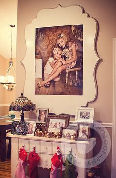 Organic bloom frame over console table. Copying in black for the den! I need a frame this for my girls picture