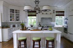 White kitchen, gray marble, dark hardwood floors