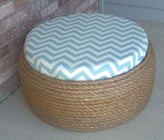 Such a great idea- Use an old Tyre Tie rope around it Wooden top with fabric or just an cushion