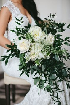 Rose and cascading greenery wedding bouquet: http://www.stylemepretty.com/canada-weddings/british-columbia/vancouver/2017/04/06/classic-hotel-wedding/ Photography: Melia Lucida - http://lucida-photography.com/