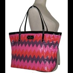 Large Kate Spade Beverly Breeze Tote Gorgeous woven leather chevron tote with black patent trim and strap.  Open top.  Bright pink interior includes 2 slide pockets and 1 zipper pocket.  Bottom has 4 feet.  This is pre-loved and shows wear on the bottom as pictured.  Interior also has some markings as shown.  All are reflected in price.  Structurally sound with plenty of life left.  Measures 18x6.5x11 kate spade Bags Totes