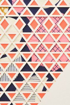 Multiple layer, laser cut artwork from designer and architect Molly McGrath. Cream and coral papers are intricately cut to reveal the Dutch superwax fabric behi