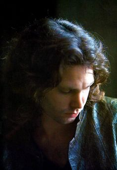 """Jim Morrison photographed by Linda McCartney, 1968 """"At the Cloisters. Natural light was used. Jim was sitting inside the museum and it was pouring with rain outside."""""""