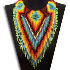 Embera Chami Puru statement flower necklace. Beautiful choker necklace with blue flowers hanging in a V pattern. Add some color to your little black dress or dress-up a casual tank top. Ball and loop
