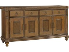 Give your dining room a look of relaxation, summertime, and timeless style with this tropical, yet elegant buffet. The buffet features design elements such as bun feet, decorative braid motif, and bamboo carved posts with leather wrapped pencil rattan accents. The buffet has four felt lined drawers with silver trays in the middle two drawers for storing your finest silverware. For even more storage space the piece has four wood framed doors with pencil rattan panels, each set of doors…
