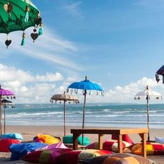 Kuta Beach, Bali :: Used in #Hindu ceremonies, the #Balinese decorate their #temple compounds with colourful umbrellas. In the Balinese dialect these umbrellas are known as 'tedung', which literally means 'to guard'.