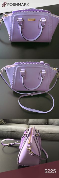 """Kate Spade Satchel Handbag Authentic Kate Spade Marguerite Lilac Road Leather Satchel Handbag. Color is a beautiful bright lilac. Perfect for spring/summer! Bag is preowned & in excellent condition. 14k light gold plated hardware. Leather is smooth/buttery. Kate Spade New York logo on front. Leather trim with scallop detail. Top zip closure, Inside zip pocket, and two interior slip pockets. Adjustable/Removable crossbody strap. Dual roll top handles with a 4"""" drop. 12"""" (L) x 8"""" (H) x 5 1/2""""…"""