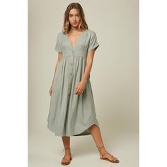 "This is a woven midi dress that has a front button closure and deep-v neckline. It has short sleeves and on seam pockets. 45"" In length Short sleeves Front button closure V-neckline On seam pockets Metal logo badge 100% Viscose"