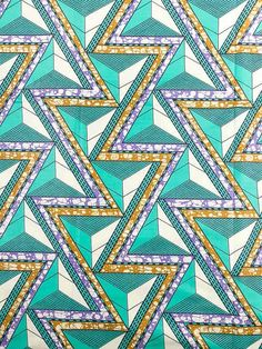 love the colors and early 90s vibe of this African wax print fabric
