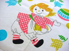 Vintage 60s whimsical Juvenile Fabric with an array of checked daisy flowers, tulips, toys and rag dolls playing. They look like Raggedy Ann &