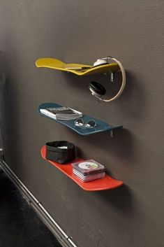 Such a great idea for people with kids or outgrown skateboards/snowboards... Just spray paint to match decor and use as shelving! Love this, practical idea!