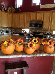 fill a carved out pumpkin with in season flowers as cute centerpieces