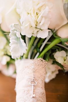 "Inspiration is all around you. This SMP bride used  a Tiffany KEY that her mum had given her for her wedding inspiration: ""Love Is Key"". See the wedding on SMP: http://www.StyleMePretty.com/canada-weddings/2014/02/20/key-themed-wedding-at-hotel-eldorado/ Kevin Trowbridge Photography"