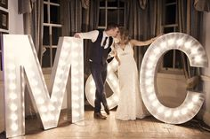 Who doesn't want to see their name in big, bright marquee lights? These lighted monograms create photo-ops while putting your stamp on the entire reception. Most monograms can be rented or purchased — or you can DIY your own!