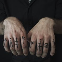 Rune tattoos on fingers