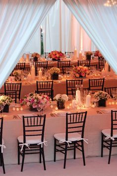 "At a seated reception, guests dine inside a beautiful white tent on the Versailles gardens in Paradise Island, Bahamas [Summer 2011, Department: Wedding Flowers, Favors, and Food ""Amory and Sean"", Photography: Jake McBride, Christian Oth Photography]"