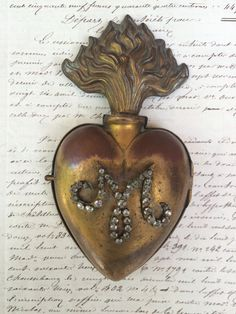 French Ex Voto Reliquary with Paste by ReCastJewelry on Etsy https://www.etsy.com/listing/236851061/french-ex-voto-reliquary-with-paste