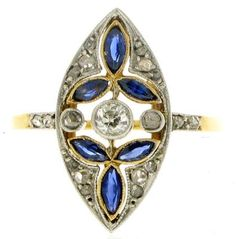 Marquise shape sapphire and diamond ring. Millegrain settings throughout, mounted and set in platinum and yellow gold, circa 1910.