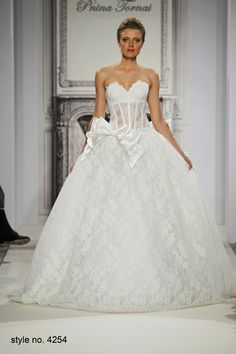 strapless,sweetheart lace ball gown with illusion bodice and cascading bows.  #pnina_tornai collection 2014. #weddings