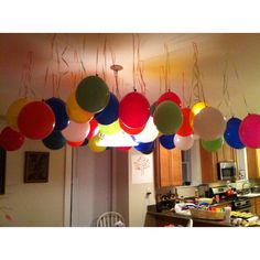 Upside down balloons hanging from ceiling. Easy and out of the way!