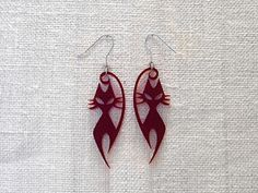 Enjoy the Angry-cat earrings on silver plated handmade hooks.  ...now in Burgundy red, black, white, blue, yellow and fuchsia to choose from!