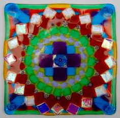 Deb A., has added another beautiful tile to her series of squares. She had used dichroics, millefiori, and irids. with a dynamic mix of transparent & opals!