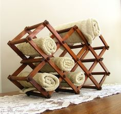 All sorts of wine racks can also be used as towel racks. You can hang wire wine racks on the wall as well!