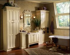 Fairport in Birch Antique Biscotti with Taupe Glaze imparts an heirloom quality to this beautiful bath. Crown moldings, unique hardware and towel cubbies personalize the space while natural light and fresh flowers keep it airy. Kraftmaid, Bathroom Renos, Country Bathroom, Home, Bathroom Cabinetry, Country Bathroom Vanities, Kitchens Bathrooms, Bathrooms Remodel, Bathroom Design