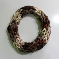 "Cool Infinite Scarf - Handmade scarf by ""Natyra Knitting Prizren"". It is made from different shades of brown yarn and is knitted in rope form. It is soft, warm and very stylish. Why not upgrade your look with this cool scarf?!"
