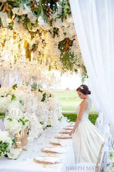 <3 Wedding Decor - Love the hanging flowers, but perhaps utilize lower centerpieces to facilitate conversation?