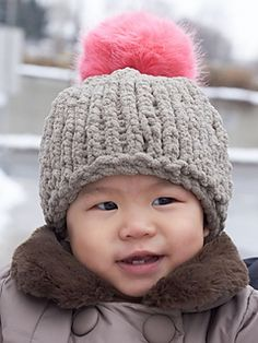 Cozy baby hat with a huge adorable faux fur pompom! (Yarnspirations)