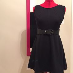 Handmade black dress with red stitching Never worn...Cute little handmade dress with red stitching. It's ponte knit. Super comfy...Approx measurements are.. bust 34-1/2....waist 28...length 31-1/2. The inside is sewn with white surging. Belt sold separately...I have a bundle discount. Handmade Dresses Mini