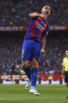 Barcelona's forward Paco Alcacer celebrates after scoring during the Spanish Copa del Rey (King's Cup) final football match FC Barcelona vs Deportivo Alaves at the Vicente Calderon stadium in Madrid on May 27, 2017. / AFP PHOTO / Josep LAGO