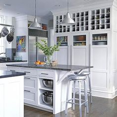Built-In Pantry Cabinets             Generously sized built-in cabinets house pantry items close at hand. Ribbed-glass doors provide a visual transition to the wine racks that take advantage of space above pantry cabinets