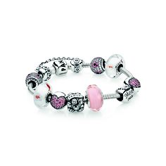 PANDORA - Sterling silver bracelet RRP $89, Floating Cherry Blossom Murano Charm RRP $39 each, Cherry Blossom Pavé Charm RRP $69 each, Mum Heart Charm RRP $35, Family Charm RRP $45, Pavé Heart Fixed Clip RRP $59 each, Pink Faceted Glass Charm RRP $49 and Hearts Safety Chain RRP $49