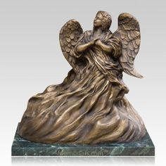 The Upward Angel Cremation Urn is made from solid bronze by the lost wax cast method with a natural bronze patina and a protective lacquer finish. Mounted on a deep green marble base.
