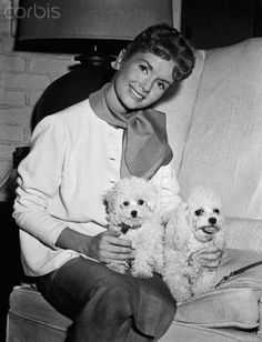 Debbie Reynolds with her two poodles