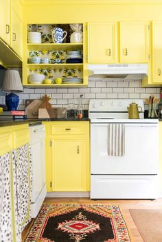 Amanda Louise Interiors Yellow Kitchen Photo by Luke Cleland