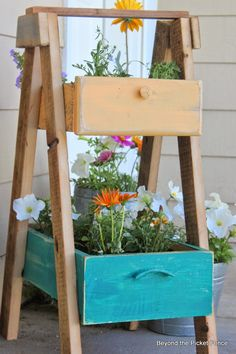 This tiered planter was built using drawers to house colorful blooms.