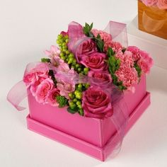 Pink floral arrangement in pink box with lid, design features roses, hypericum and alstroemeria in a keepsake box.Approximate Dimensions: Height Width Depth 8 Substitutions of equal or greater value may be made depending on season and availability. Valentines Flowers, Mothers Day Flowers, Deco Floral, Arte Floral, Floral Foam, Flower Boxes, My Flower, Flowers In A Box, Pink Roses