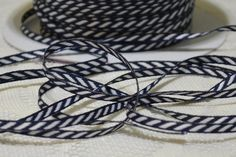 This listing is for 5 yards of 1/8 inch wide woven ribbon. It has navy and white diagonal stripes. This is a very narrow ribbon and would be