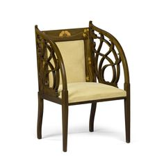 Art Nouveau  chair. Beautiful inlay, fabulous carved arms, and a warm patina to the mahogany circa 1895